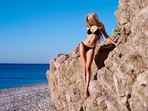 Beautiful slender blonde at the sea Stock Photography