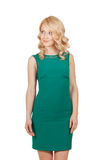 The beautiful, slender blonde woman in green dress Royalty Free Stock Photos