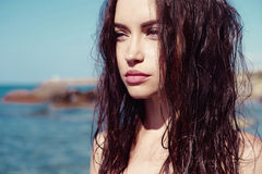 Beautiful slender brunette at the sea stock photography