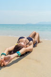 Beautiful, slender girl in bikini sunbathing Royalty Free Stock Photos
