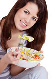 A beautiful slender girl eating healthy food Stock Photography