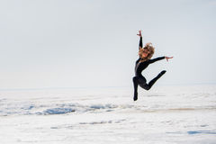 Beautiful slender girl jumps Royalty Free Stock Image