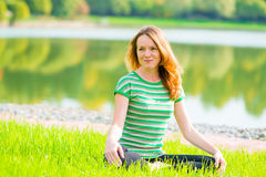 Beautiful slender girl is preparing for yoga Royalty Free Stock Photo