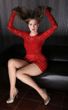 Beautiful slender girl in red dress Royalty Free Stock Image
