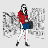 Beautiful, slender girl in shorts, jacket and sneakers. Fashion clothes. Vector illustration. Royalty Free Stock Photography