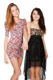 Beautiful slender girlfriends shake hands Stock Image