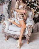 Beautiful slender legs of a woman in a luxurious Christmas inter stock photos