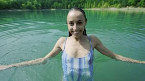Beautiful slender sexy happy woman in blue swimwear relaxing, swimming and enjoying fresh water in mountain lake at hot. Sunny summer day. adorable sexy sensual stock video