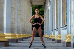 Beautiful slender sports woman dancer in a black suit and pointe dancing stock photos