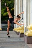 Beautiful slender sports woman dancer in a black suit and pointe Royalty Free Stock Images