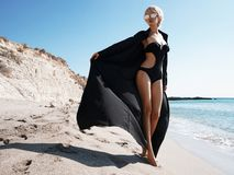 Beautiful slender woman in black tunic royalty free stock photography