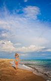 Beautiful slender woman on the sea beach Stock Photo