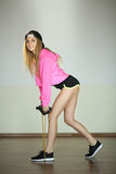 Beautiful slender young girl. Beautiful young athletic girl on training in a sports hall Stock Photo