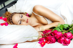 Beautiful slepping woman with red roses Royalty Free Stock Photography