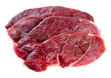 Beautiful slices of organic Australian raw uncooked lamb leg ste Royalty Free Stock Photography