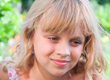 Beautiful slightly smiling little blond girl Royalty Free Stock Photography