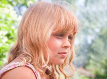 Beautiful slightly smiling little girl portrait Stock Images