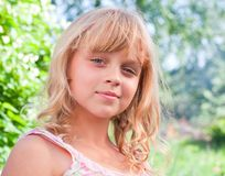 Beautiful slightly smiling little girl portrait Royalty Free Stock Image