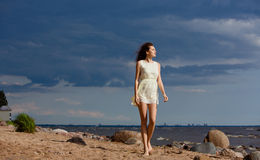 Free Beautiful Slim Barefoot Girl Walking On A Beach Against The Sea Stock Photos - 90570253