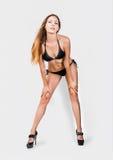 Beautiful slim bikini model, long legs and perfect body Stock Photography