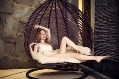 Beautiful slim blond woman relaxing Stock Image