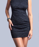 Beautiful slim body of woman in a black dress. Close up of slim woman's body wearing a black dress stock photo