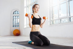 Beautiful slim brunette  doing some push ups a the gym Stock Photography
