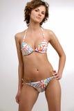 Beautiful slim brunette girl in bikin 2. Young beautiful brunette girl in bikini on white background Royalty Free Stock Photo
