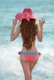 Beautiful slim brunette girl model wearing in fashion bikini and Royalty Free Stock Images