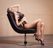 Beautiful slim brunette in lingerie. Royalty Free Stock Photos