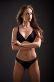 Beautiful slim brunette in lingerie. Royalty Free Stock Image