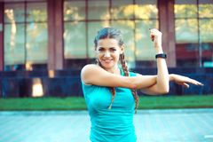 Content sportswoman stretching on street stock images