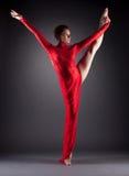 Beautiful slim dancer doing vertical split Stock Photo