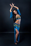 Beautiful slim flexible sexy woman belly dancer. With long glossy hair Royalty Free Stock Photos