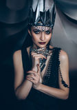 Beautiful slim girl. In the arms of shadow, dark queen, fantastic shot, toning fashionable, creative colors Royalty Free Stock Photos
