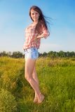Beautiful slim girl on background of the nature Stock Photography