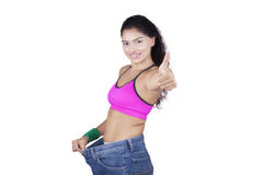Beautiful Slim Girl in her Old Jeans Royalty Free Stock Image