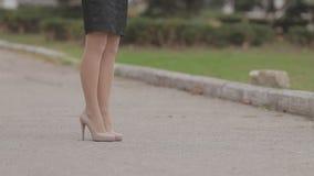 Beautiful slim girl in high heels standing in the stock video