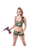 Beautiful slim girl posing with drill Royalty Free Stock Image