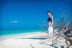 Beautiful slim girl stay on beach with thorny Royalty Free Stock Image