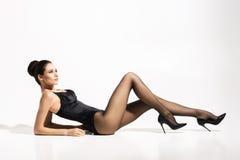 Beautiful, slim lady wearing provocative pantyhose Royalty Free Stock Image