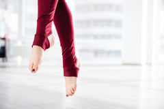 Beautiful slim legs of sportswoman in the air Stock Photo