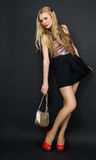 Beautiful slim model flirting on a black background Stock Photography