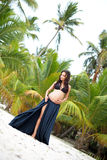 Beautiful slim pregnant girl goes to sandy beach. Tropical nature, palm trees. Stock Images