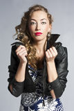 Beautiful slim sexy blond, girl in leather jacket Stock Photography