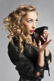 Beautiful slim sexy blond, girl in leather jacket Royalty Free Stock Photo