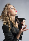 Beautiful slim sexy blond, girl in leather jacket Royalty Free Stock Photos