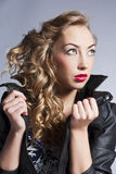 Beautiful slim sexy blond, girl in leather jacket Royalty Free Stock Photography