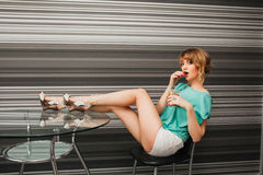 Beautiful slim sexy girl in the kitchen Royalty Free Stock Images
