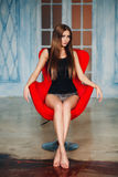 Beautiful slim sexy  girl with long hair in black Royalty Free Stock Image